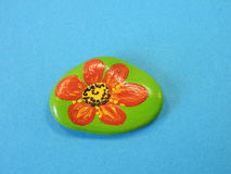 Stone with painted flower Stock Images