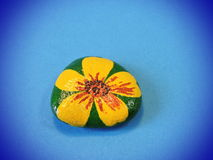 Stone with painted flower Stock Photos
