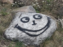 Stone with painted happy face Royalty Free Stock Photography