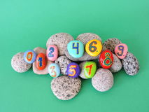 Stone with painted numbers. Colorful natural stones with painted numbers Stock Photo