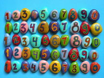 Stone with painted numbers Royalty Free Stock Image