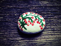 Stone with painted pink flowers Royalty Free Stock Photo
