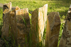 Stone palisades. Beautiful stone palisades on summer day in lawn Royalty Free Stock Photo