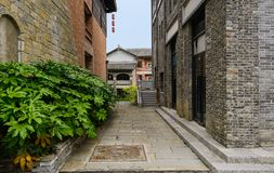 Stone passage between old-fashioned buildings in cloudy afternoon. Qingyan town,Guiyang,China royalty free stock photography