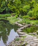 Stone path across water- ishibashi Stock Photo