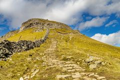 A stone path descending from PenyGhent. Royalty Free Stock Image