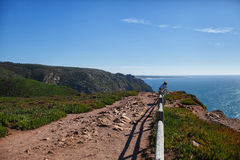 Stone path with a fence. On the edge of the cliff stock image