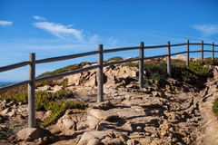 Stone path with a fence. On the edge of the cliff stock photos
