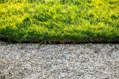 Stone path and fresh green grass at sunny day Royalty Free Stock Image