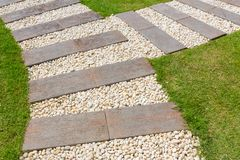 Stone path in garden. Beautiful stone and wood path in garden Stock Images