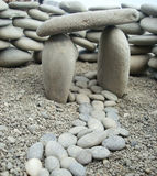 Stone path, gates and wall composed of small rocks stock image