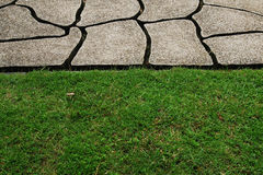 Stone path through a green lawn Royalty Free Stock Photo