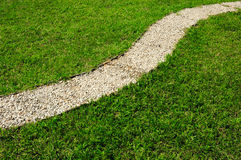 Stone Path in Green Lawn Royalty Free Stock Image