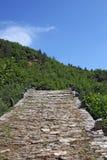 Stone path Kalogeriko bridge Zagoria. Greece Stock Photography