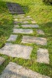 Stone path on lawn Stock Photo