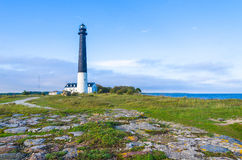 Stone path leading to the Sõrve Lighthouse in Estonia. Situated on the Sorve Peninsula on the Baltic Sea, this handsome tower is one of Estonia's best Royalty Free Stock Image