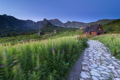 Stone path and mountain shelters in high mountains stock photography