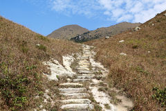 Stone path in the mountains Stock Photography