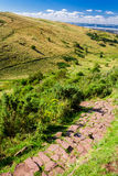 Stone path in the mountains Stock Images