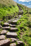 Stone path in the mountains leading to the peak stock photo