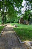 The stone path in the park on a summer day. Stock Image