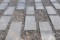 Stone Path on pebbly. In garden Royalty Free Stock Images