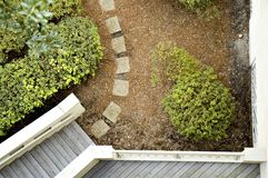 Stone Path and Stairs. View from above of stone path, stairs, balcony and bushes Royalty Free Stock Photos