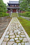 Stone path and stairs lead to a Japanese home. Japanese home and long sidewalk Stock Photography