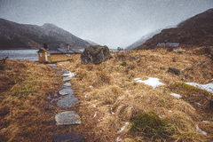 Stone path to the wood house. Near the lake Royalty Free Stock Photography