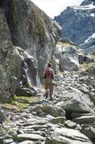 Stone path with trekking woman Royalty Free Stock Photos