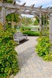 Stone Path Under Wooden Arbor Stock Photo