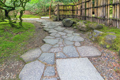 Stone Path Walkway with Bamboo Fence. At Japanese Garden Royalty Free Stock Photography