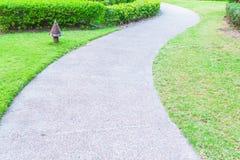 Stone path way around beautiful garden Royalty Free Stock Image