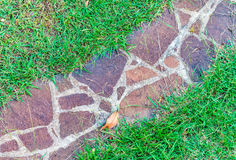 Stone path winding in autumn garden Stock Photo