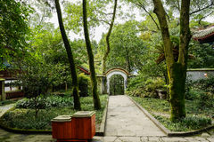 Stone path in woody yard of ancient Chinese buildings Stock Image