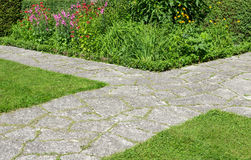 Stone paths crossing in a garden Stock Image