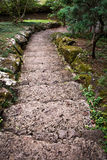 Stone Pathway. Stone stairway path leading down through green landscape Stock Photo