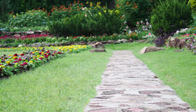 Stone pathway into garden Stock Image