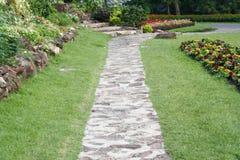 Stone pathway into garden Stock Photos