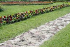 Stone pathway into garden Stock Photo