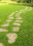 Stone pathway on grass. Royalty Free Stock Photos