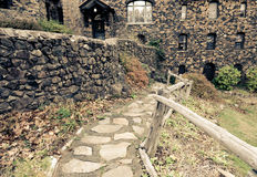 Stone pathway leads to old english style stone house Stock Image