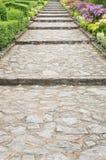 Stone pathway pass through a garden Stock Photos