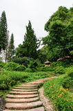 Stone pathway. Through a tranquil garden Stock Image