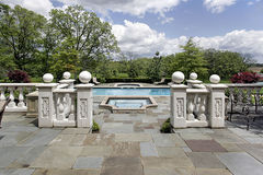 Stone patio and pool. View of stone patio and swimming pool Royalty Free Stock Photos