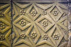 Stone pattern. An ancient pattern carved from stone provides a versatile background stock images