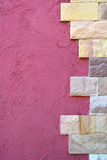 Stone pattern on pink cement wall. Royalty Free Stock Image