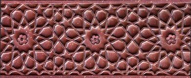 Stone pattern on a temple wall in Red Fort, Agra. India Stock Images