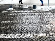 Stone pavaged pedestrian crossing in a small town. At winter time Royalty Free Stock Images