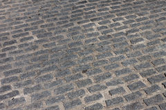 Stone paved avenue street road Stock Images